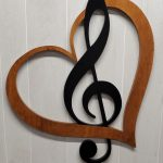 Music lover stained heart with black clef mark.